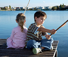 Li'l Angler fishing on a dock